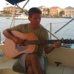 """Sailing Travel Blog: Conrad playing the guitar in Pensacola Beach FL"""