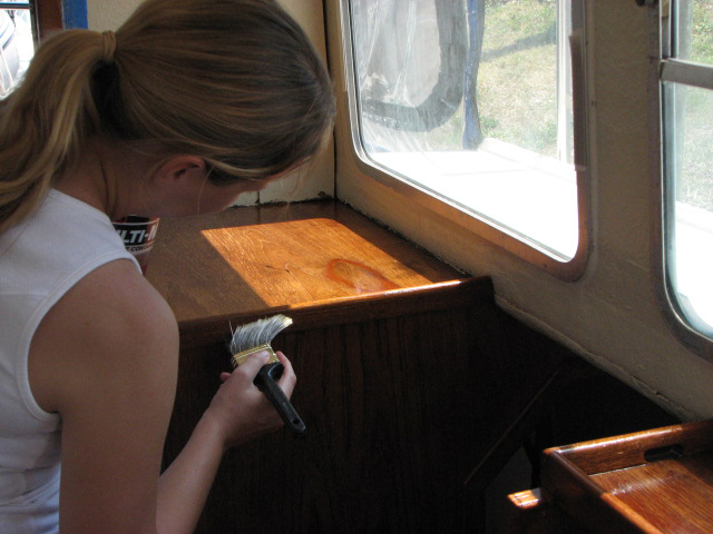 Roxanne applying poly in pilot house