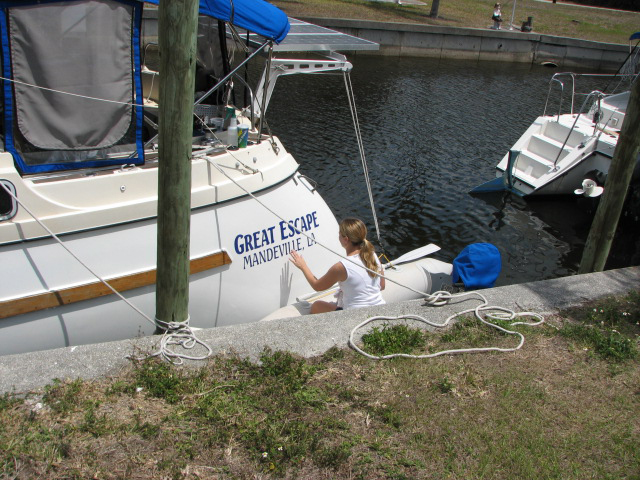 Roxanne working on the boat name