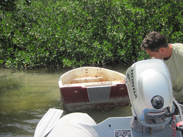 Too shallow to motor, had to row it out of the mangroves.