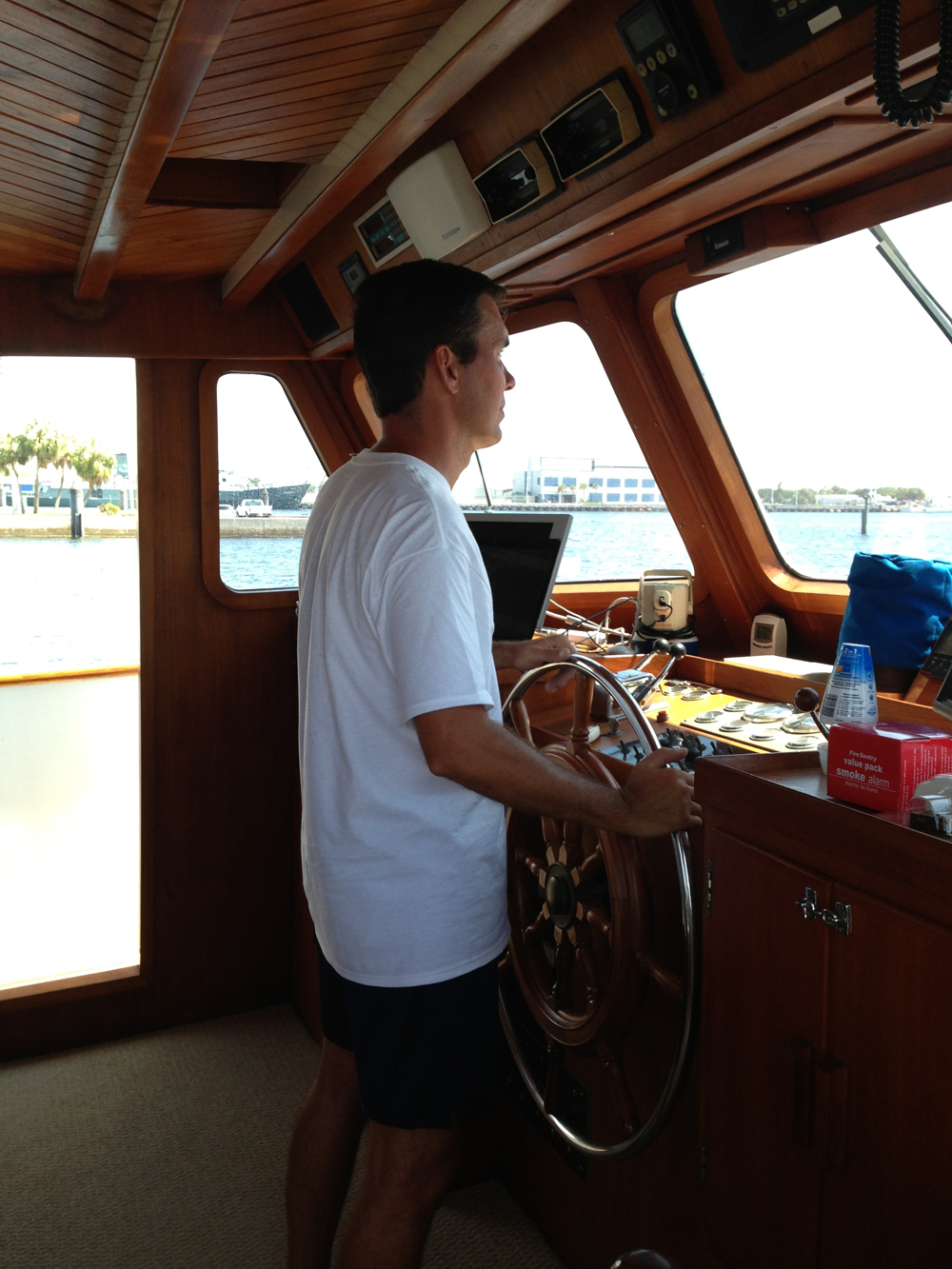 Captain Conrad at the helm. The teak herring-bone ceiling is beautiful.