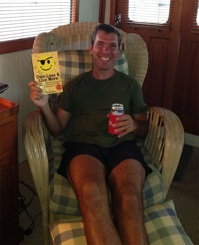 "Conrad with the ""Proof"" version of his book and a victory beer."